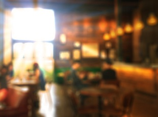 Wood tabletop with blur coffee shop background